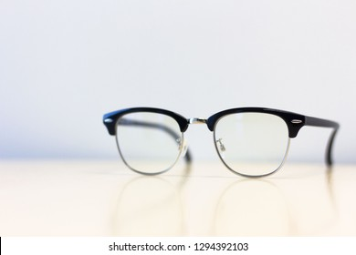 Close up side view  glasses on  desk table