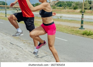 Close up side view photo of athletes legs running up concrete stairs