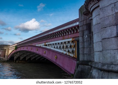 Close up side view of Southwark Bridge on the river Thames. London, United Kingdom.