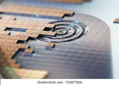 Close up silicon die in silicon wafer during die attach process in semiconductor manufacturing