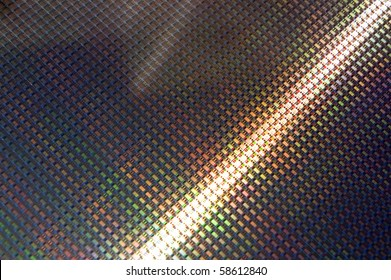 Close up of a silicon wafer of SIM computer chips.