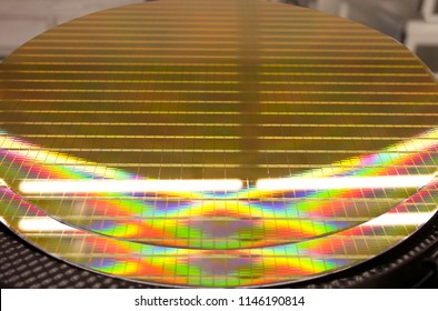 Close up of Silicon wafers prepared for production was left placed on the black box in semiconductor hi-tech industry, image light reflector