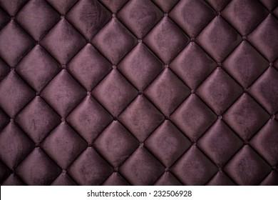 close up of silk burgundy sofa