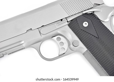 close up of a silver automatic firearm