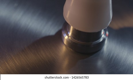 Close up for silver cymbal plate, part of drum set being prepared for the playing. Action. Beautiful shining metal drum plate, rock music concept.