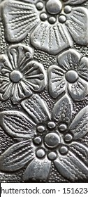 close up of an silvery engraving