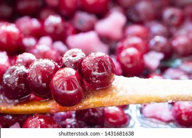 Close up of simmering homemade cherry jam. Cherry and sugar crystal.Cooking Homemade Cherry Jam. Close-up. - Shutterstock ID 1431681638