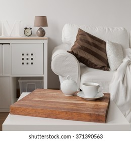 Close up of simple white coffee table