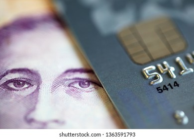 close up of singapore banknote with credit card