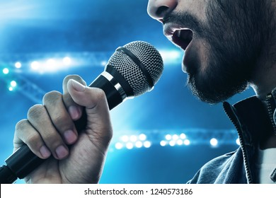 Close up singer singing with microphone