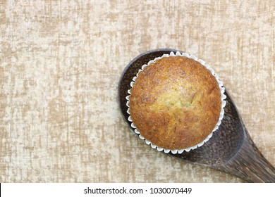 Close up single banana cup cake bakery top view on wood ladle look delicious on wooden table background have copy space for out text or recipe for make it.