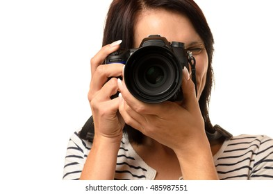Close up of single woman pointing a professional single lens reflex camera over white background
