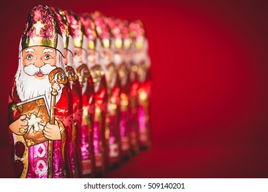 Close up of Sinterklaas. Saint  Nicholas chocolate figures of  Dutch character of Santa Claus.with copy-space.