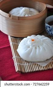Close up Siopao Chinese pork bun on bamboo mat