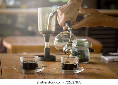 close up of siphon vacuum, coffee cup and siphon vacuum coffee maker at shop.