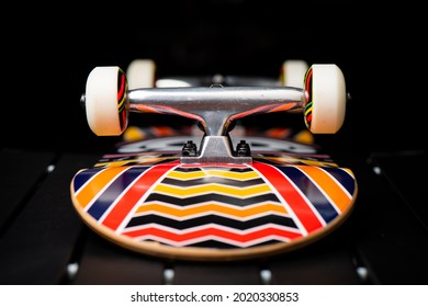 Close up skateboard wheel and truck on brand new skateboard.