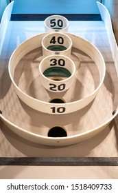 close up of skeeball game found at arcades or carnivals.