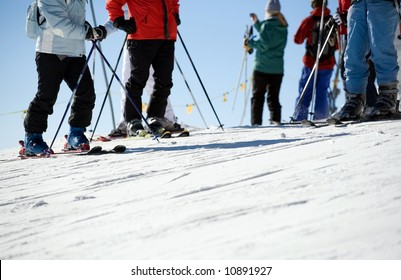 Close up of skiers on piste