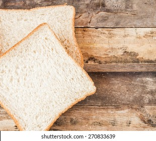 Close up slice bread on a wooden background