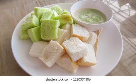 close up of Slice steamed bread and pandan custard, Thai dessert