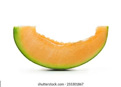 Close up of sliced cantaloupe on white background