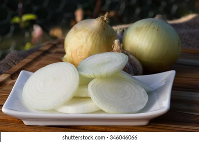 close up of sliced raw organic sweet onions  on a plate