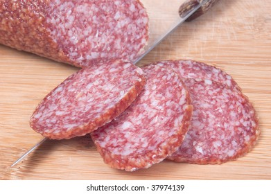 Close up of sliced salami on cutting board