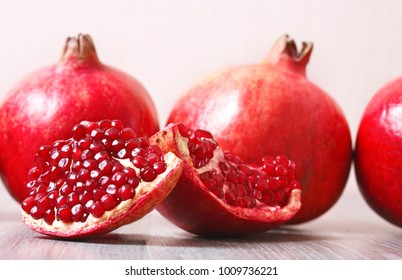 Close up sliced and whole pomegranate on a table