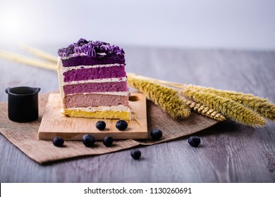 Close up slices of blueberry layer cakes on a wood tray. Dessert for Wedding and Birthday concept.