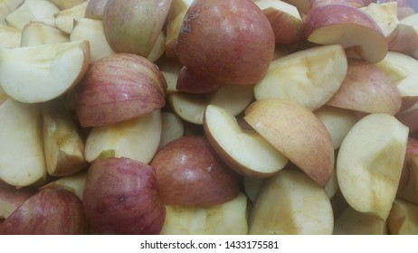 Close up of slices of red and green apples. Fruit background with copy space for text and advertisements