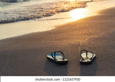 Close up slipper on the beachfront at sunset