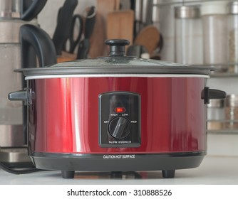 Close up of a slow cooker working on kitchen shelf