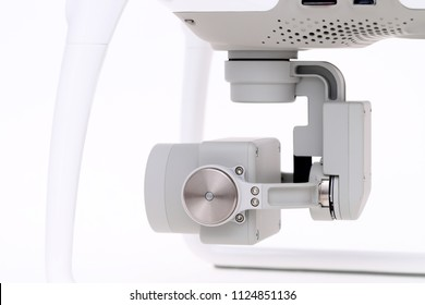 Close up of small camera on gimbal of drone, studio photo of a drone aircraft on white background