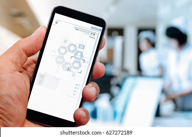 close up of smart medical doctor hand working with mobile phone stethoscope with modern hospital background