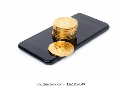 Close up of a smartphone with bitcoin on white background, Gold Bitcoins.