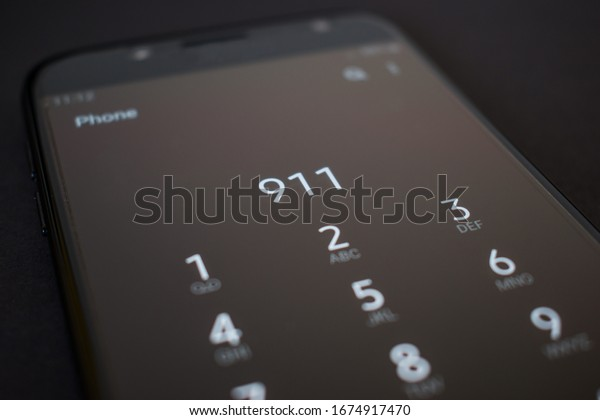 Close up smartphone calling 911 emergency services number. Call 911