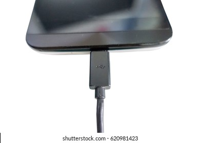 Close up of smartphone charging on white background, Selective focus