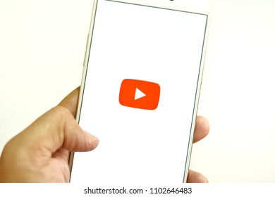 Close up smartphone on left hand with YouTube sign loading.YouTube is video sharing website for enjoy the videos,music and share with friends,family and the world.June 1,2018.Chiang Mai,Thailand.