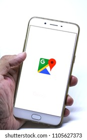 Close up smartphone on left hand with Google maps application sign.Google Maps is a web mapping service for find local businesses,view maps and get driving directions.June 5,2018.Chiang Mai,Thailand.