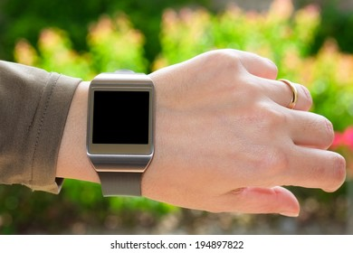 Close up of smartwatch on the turned wrist as a concept of wearable technology