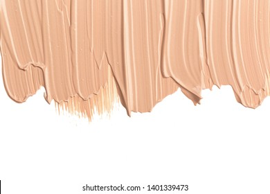 Close up of smear beige and ligth pink tone foundation texture for background.