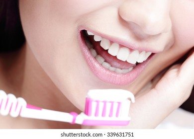 Close up of Smile woman brush teeth. great for health dental care concept, asian beauty