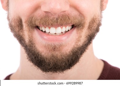Close up of smiling face, young man giving a smile, isolated on white background