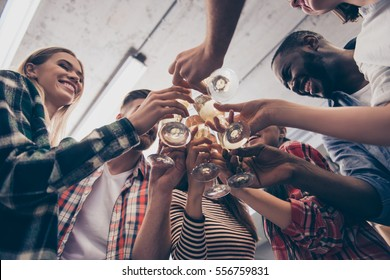 Close up of smiling friends toasting glasses of champagne