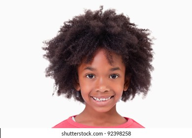 Close up of a smiling girl against a white background