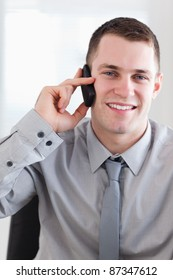 Close up of smiling happy businessman getting good news on the phone