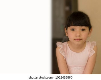close up smiling little girl's face with ballerina outfits and white space for background