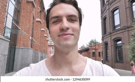 Close Up of Smiling Man Walking on Street