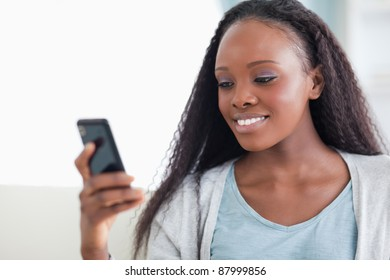 Close up of smiling woman reading a text message