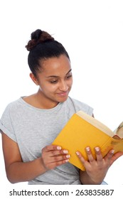 Close up Smiling Young Asian Indian Woman in Casual Shirt Reading a Yellow Book, Isolated on White Background.